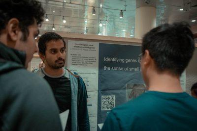 students looking at display