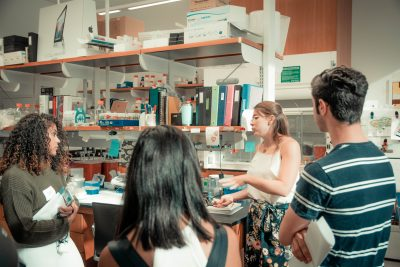 students discussing in lab